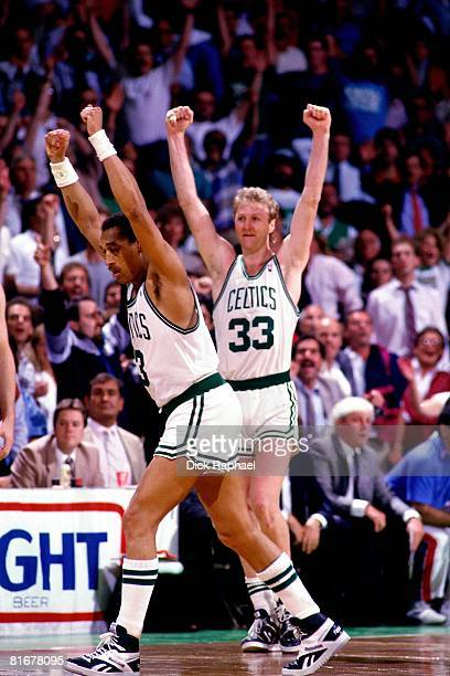 Larry Bird and Dennis Johnson of the Boston Celtics celebrate during a game circa 1984-1990 at the Boston Garden in Boston, Massachusetts. NOTE TO...