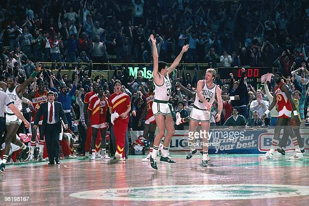 Larry BIrd and Kevin McHale of the Boston Celtics celebrate against the Atlanta Hawks during a game played in 1985 at the Boston Garden in Boston...