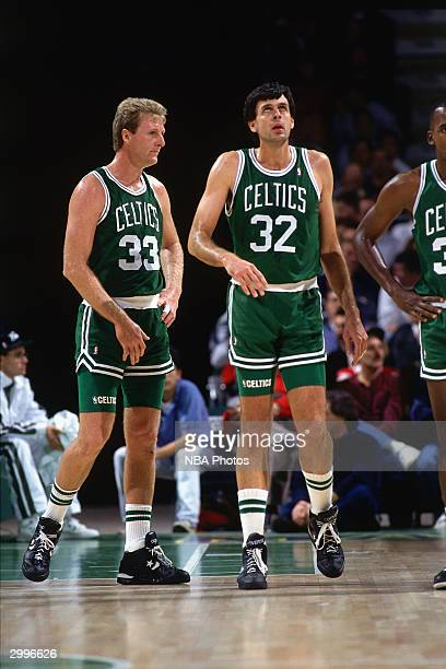 Larry Bird and Kevin McHale of the Boston Celtics look on during a break in game action against the Milwaukee Bucks circa 1991 at the Bradley Center...