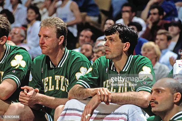Larry Bird and Kevin McHale of the Boston Celtics sits on the bench during the 1991 NBA Playoffs at the Boston Garden in Boston Massachusetts circa...