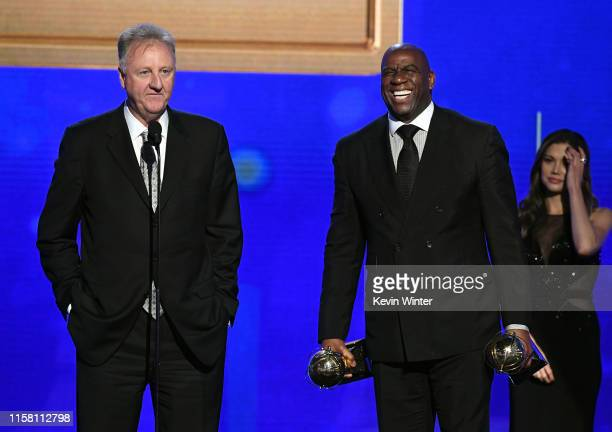 Larry Bird and Magic Johnson accept the Lifetime Achievement Awards onstage during the 2019 NBA Awards presented by Kia on TNT at Barker Hangar on...