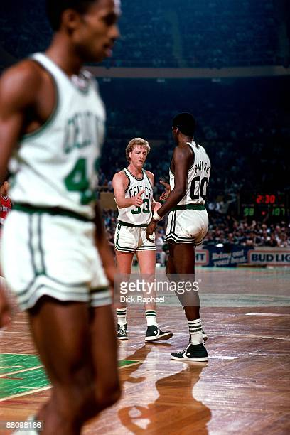 Larry Bird and Robert Parish of the Boston Celtics shake hands during a game played in 1984 at the Boston Garden in Boston Massachusetts NOTE TO USER...