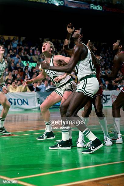 Larry Bird and Robert Parish of the Boston Celtics wait for the rebound against the Philadelpha 76ers during a game played in 1984 at the Boston...