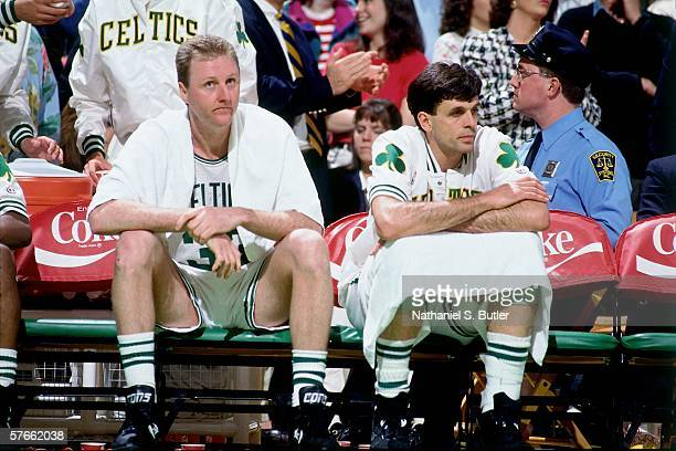 Larry Bird and teammate Kevin McHale of the Boston Celtics look on from the bench during a game played circa 1991 at the Boston Garden in Boston...