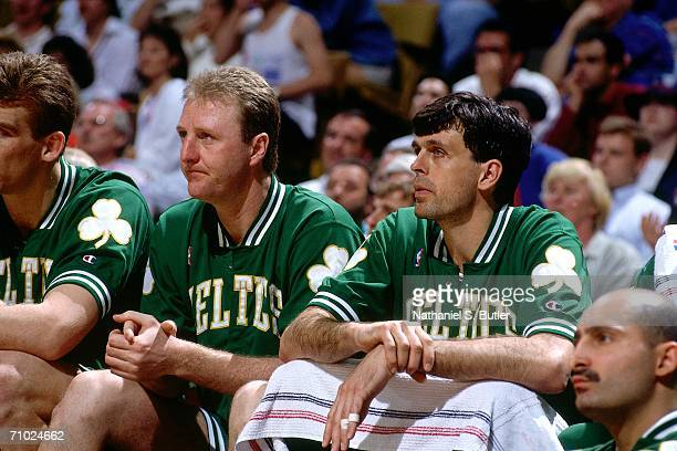 Larry Bird and teammate Kevin McHale of the Boston Celtics look on from the bench during Game one of the Eastern Conference Semifinals against the...