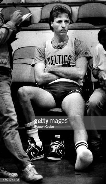 Larry Bird appears sullen at a Boston Celtics practice with one shoe off June 6 1987