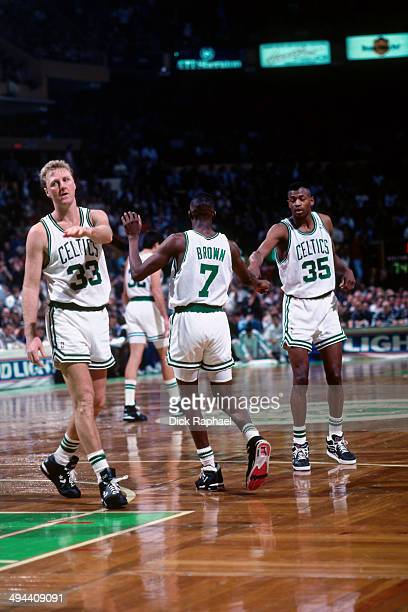 Larry Bird Dee Brown and Reggie Lewis of the Boston Celtics celebrate during a game in 1992 at the Boston Garden in Boston Massachusetts NOTE TO USER...