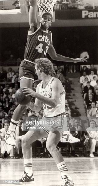 Larry Bird fakes out the Cavaliers' Brad Daugherty as the Boston Celtics play the Cleveland Cavaliers at Boston Garden during the 19861987 NBA season