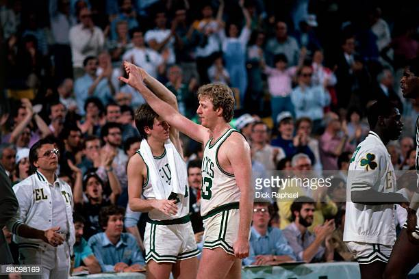 Larry Bird high fives teammate Danny Ainge of the Boston Celtics during a game played in 1984 at the Boston Garden in Boston Massachusetts NOTE TO...