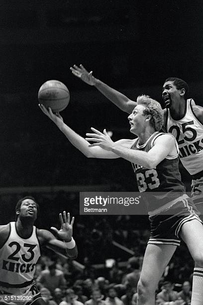 Larry Bird keeps ball from the reach of the Knicks' Bill Cartwright during their contest at Madison Square Garden, 3/5. The New Yorkers beat Boston,...