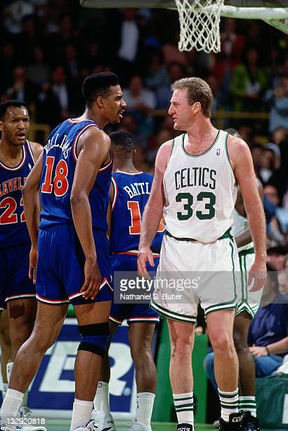 Larry Bird of the Boston Celtics and John 'Hot Rod' Williams talk during the 1991 NBA Playoffs at the Boston Garden in Boston Massachusetts circa...