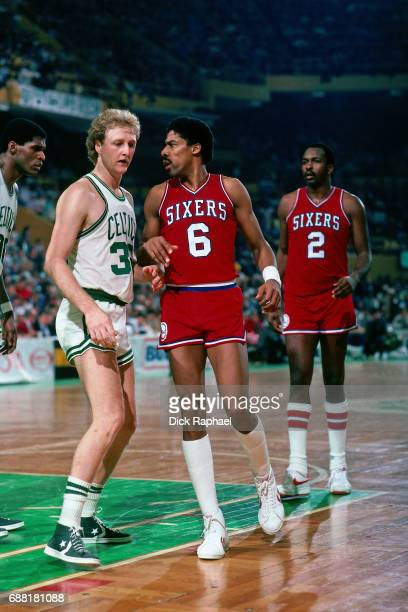 Larry Bird of the Boston Celtics and Julius Erving and Moses Malone of the Philadelphia 76ers match up during a game circa 1985 at the Boston Garden...