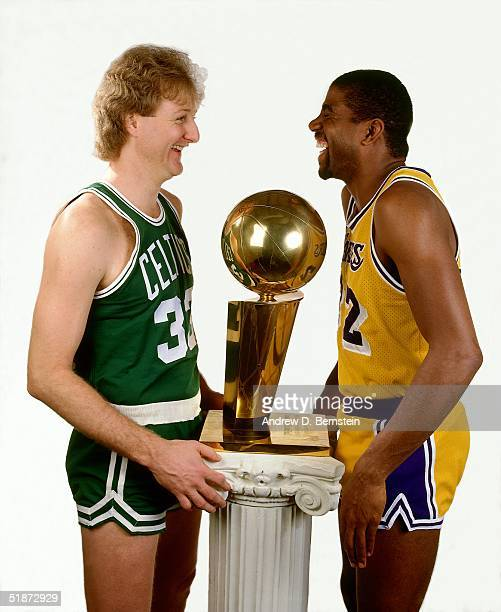 Larry Bird of the Boston Celtics and Magic Johnson of Los Angeles Lakers pose for a portrait with the NBA Champioinship Trophy in Los Angeles...