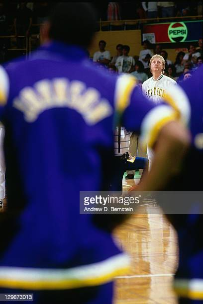 Larry Bird of the Boston Celtics and Magic Johnson of the Los Angeles Lakers stand during the 1987 NBA Finals circa 1987 at the Boston Garden in...