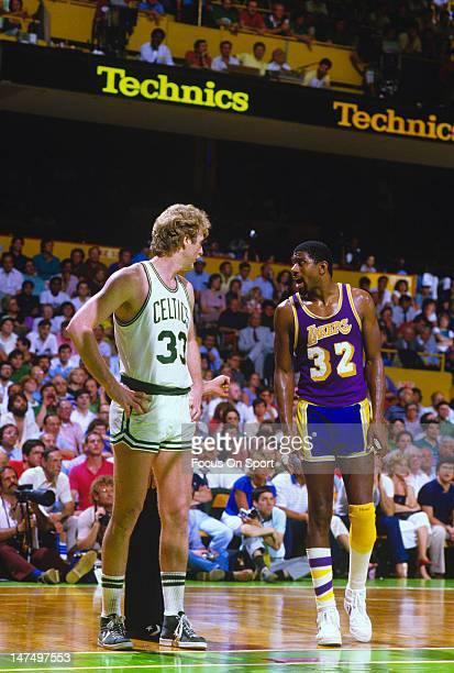 Larry Bird of the Boston Celtics and Magic Johnson of the Los Angeles Lakers looks on during the 1984 NBA Finals June 1984 at The Boston Garden in...