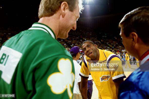 Larry Bird of the Boston Celtics and Magic Johnson of the Los Angeles Lakers meet at center court during the NBA game at the Forum in Los Angeles...