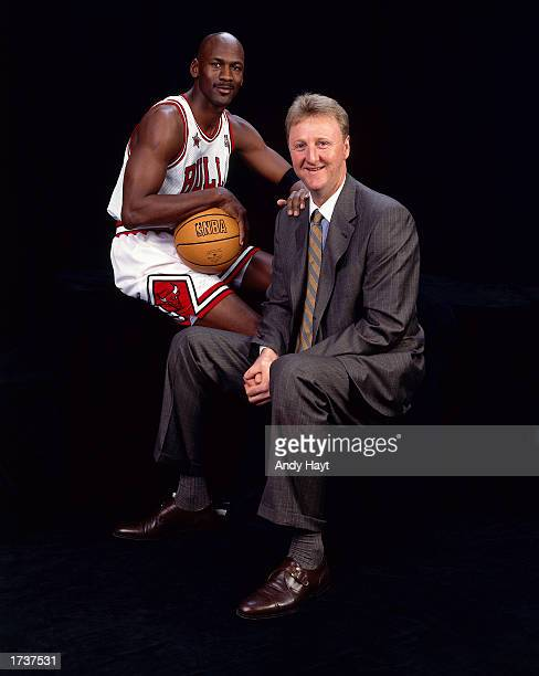 Larry Bird of the Boston Celtics and Michael Jordan of the Chicago Bulls pose for a portrait during the 1998 NBA AllStar Game at the Gund Arena on...