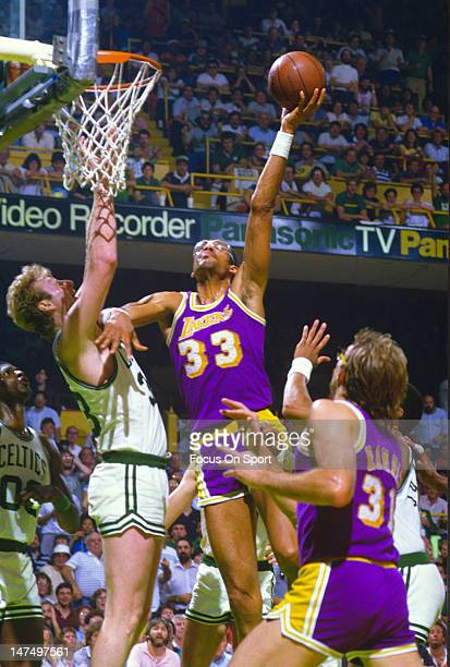 Larry Bird of the Boston Celtics attempts to stop the shot of Kareem AbdulJabbar of the Los Angeles Lakers during the NBA Finals June 1985 at The...