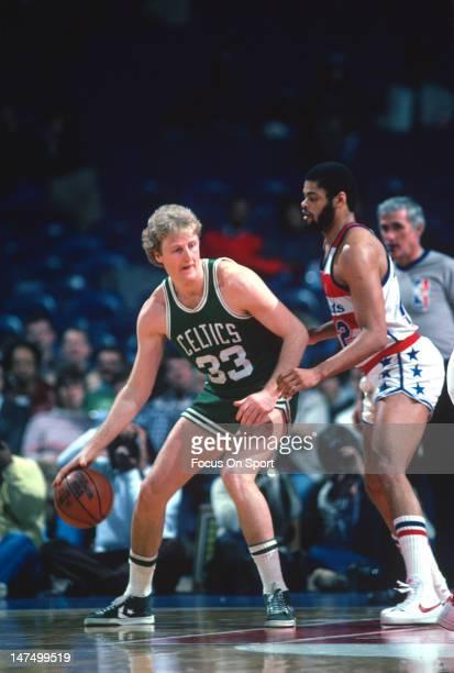 Larry Bird of the Boston Celtics backs in on Greg Ballard of the Washington Bullets during an NBA basketball game circa 1983 at the Capital Center in...