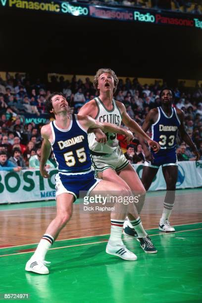 Larry Bird of the Boston Celtics battle for the rebound against Kiki Vandeweghe of the Denver Nuggets during an NBA game played in 1982 at the Boston...