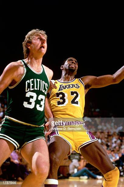 Larry Bird of the Boston Celtics battles for rebound position with Magic Johnson of the Los Angeles Lakers during the NBA game at The Great Western...