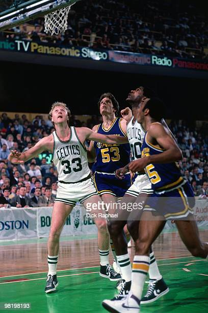 Larry BIrd of the Boston Celtics boxes out against Mark Eaton of the Utah Jazz during a game played in 1985 at the Boston Garden in Boston...