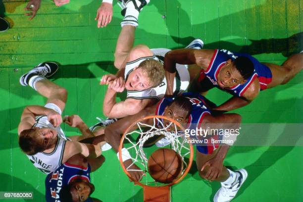 Larry Bird of the Boston Celtics boxes out against the Detroit Pistons circa 1986 at the Boston Garden in Boston Massachusetts NOTE TO USER User...