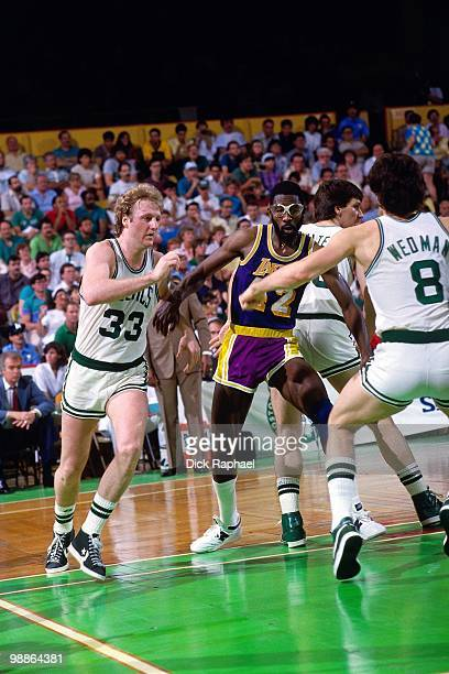 Larry Bird of the Boston Celtics cuts to the basket against James Worthy of the Los Angeles Lakers during the 1985 NBA Finals at the Boston Garden in...