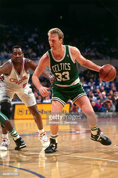 Larry Bird of the Boston Celtics dribbles against the Los Angeles Clippers during a game played circa 1991 at the Los Angeles Memorial Sports Arena...