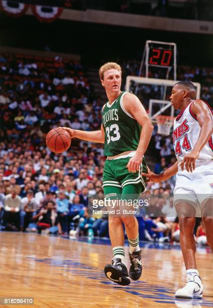 Larry Bird of the Boston Celtics dribbles against the New Jersey Nets during a game at the Brendan Byrne Arena in East Rutherford New Jersey circa...