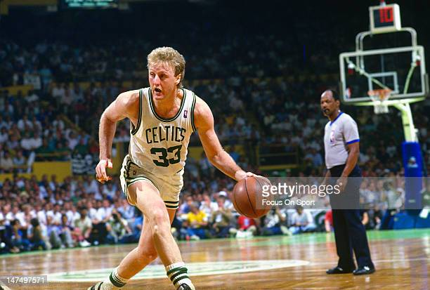 Larry Bird of the Boston Celtics dribbles the ball against the Los Angeles Lakers during the NBA Finals June 1987 at The Boston Garden in Boston...