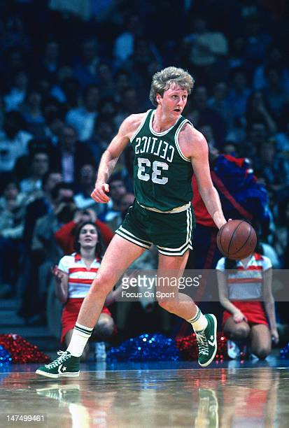 Larry Bird of the Boston Celtics dribbles the ball up court against the Washington Bullets during an NBA basketball game circa 1983 at the Capital...