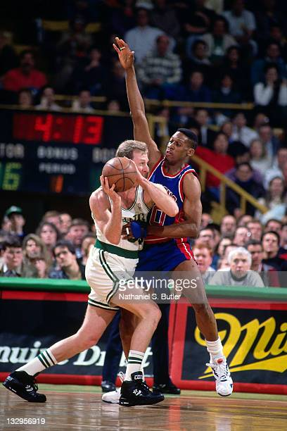 Larry Bird of the Boston Celtics drives against Dennis Rodman of the Detroit Pistons circa 1991 at the Boston Garden in Boston Massachusetts NOTE TO...