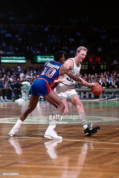 Larry Bird of the Boston Celtics drives against Dennis Rodman of the Detroit Pistons during a game played in 1992 at the Boston Garden in Boston...