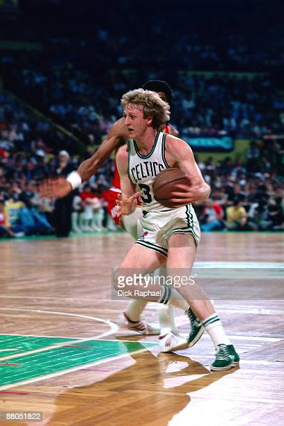 Larry Bird of the Boston Celtics drives to the baket against the Houston Rockets during the 1991 NBA Finals at the Boston Garden in Boston...