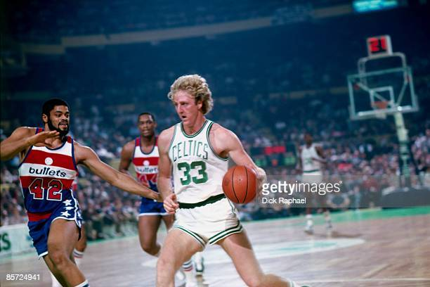 Larry Bird of the Boston Celtics drives to the basket agaimst Greg Ballard of the Washington Bullets during an NBA game played in 1982 at the Boston...