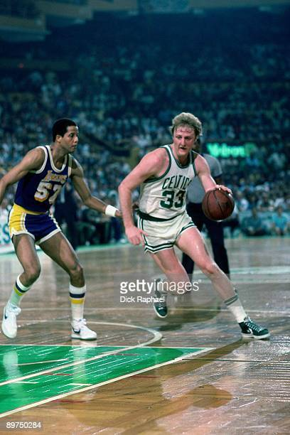 Larry Bird of the Boston Celtics drives to the basket against Jamaal Wilkes of the Los Angeles Lakers during a game played in 1984 at the Boston...