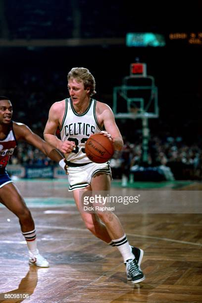 Larry Bird of the Boston Celtics drives to the basket against Rick Mahorn of the Washington Bullets during a game played in 1984 at the Boston Garden...