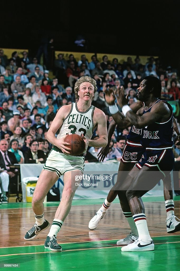 Larry Bird #33 of the Boston Celtics drives to the basket against the New York Knicks during a game played in 1983 at the Boston Garden in Boston, Massachusetts.