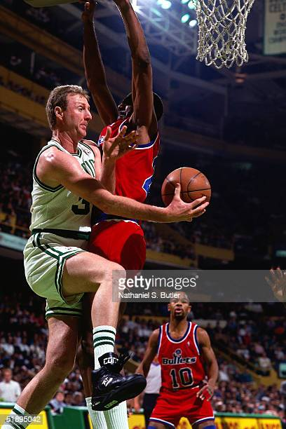 Larry Bird of the Boston Celtics drives to the basket against the Washington Bullets during an NBA game in 1987 at the Boston Garden in Boston...
