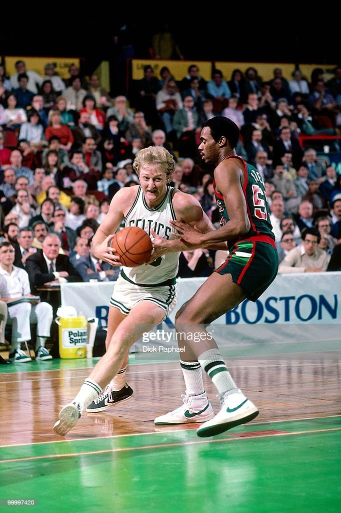 Larry Bird #33 of the Boston Celtics drives to the basket against the Milwaukee Bucks during a game played in 1983 at the Boston Garden in Boston, Massachusetts.