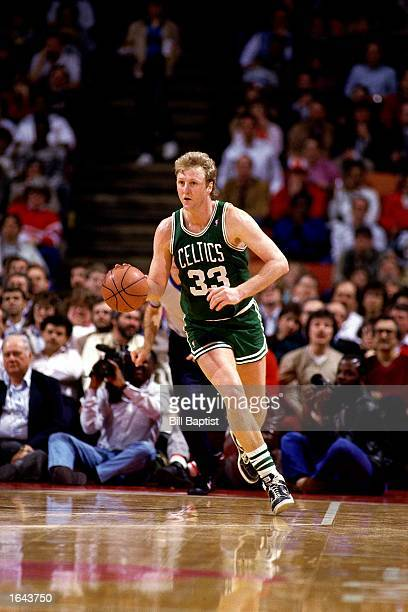 Larry Bird of the Boston Celtics drives to the basket during a 1990 NBA game against the Houston Rockets at the Summit in Houston, Texas. NOTE TO...