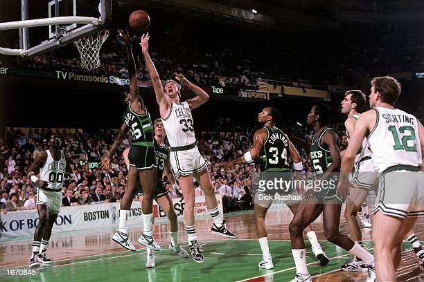 Larry Bird of the Boston Celtics drives to the basket for a layup against the Milwaukee Bucks during the 1980 NBA game at the Boston Garden in Boston...