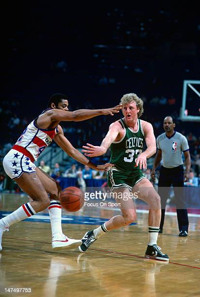 Larry Bird of the Boston Celtics gets his pass by Greg Ballard of the Washington Bullets during an NBA basketball game circa 1985 at the Capital...