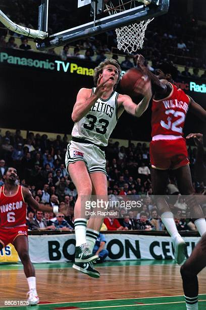 Larry Bird of the Boston Celtics goes up for a shot against Bill Willoughby of the Houston Rockets during the 1991 NBA Finals at the Boston Garden in...