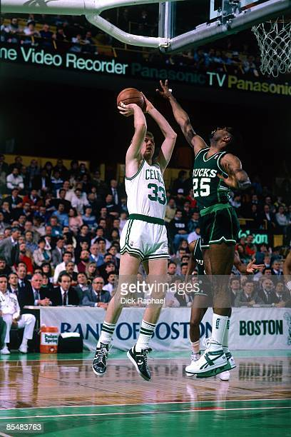 Larry Bird of the Boston Celtics goes up for a shot against Paul Pressey of the Milwaukee Bucks during a game played in 1987 at the Boston Garden in...