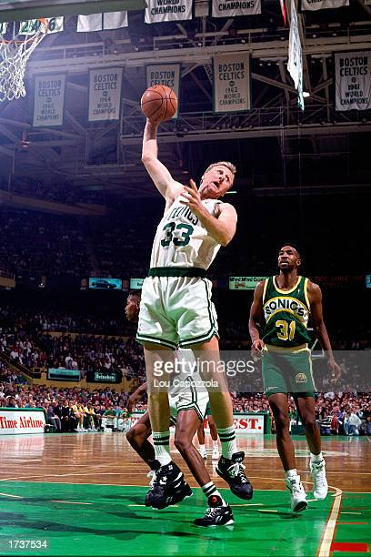 Larry Bird of the Boston Celtics grabs a rebound against the Seattle SuperSonics on January 1 1991 at The Boston Garden in Boston Massachusetts NOTE...
