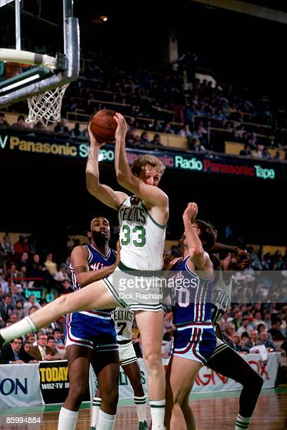 Larry Bird of The Boston Celtics grabs the rebound against Ed Nealy of the Kansas City Kings during a game played in 1983 at the Boston Garden in...