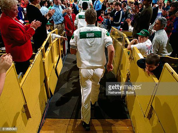 Larry Bird of the Boston Celtics heads for the court before the NBA game at the Boston Garden in Boston Massachusetts NOTE TO USER User expressly...