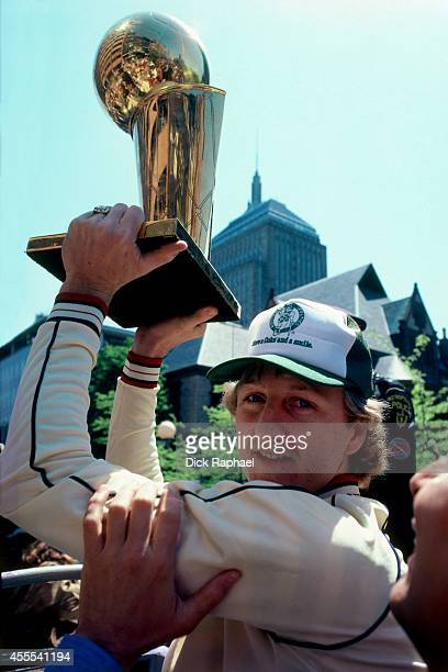Larry Bird of the Boston Celtics holds the championship trophy over his head during their 1997 Championship parade in Boston Massachusetts NOTE TO...
